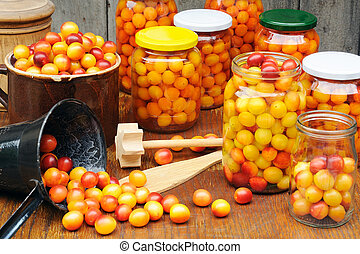 Preserving Mirabelle plums - jars of homemade fruit...