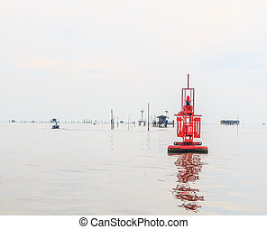 floating red beacon in sea ocean in Gulf of Thailand