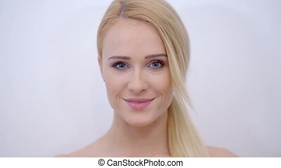 Smiling Face of Blond Woman Looking at Camera - Close up...