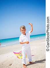 Boy with kite - Summer vacation - Cute boy flying kite beach...