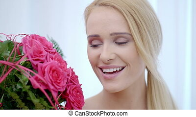 Happy Woman with a Bouquet of Pink Rose Flowers