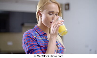 Pretty Blond Woman Drinking Juice from a Glass - Close up...