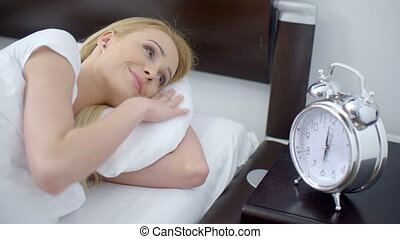 Sleeping Woman Turning Off an Alarm Clock - Close up Lying...