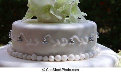 wedding cake decorated with orchid and bead - rotating close...