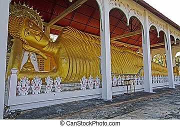 Stature big buddha sleep at Wat Som Det Temple, Sangkhla...