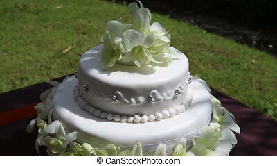 wedding cake decorated with orchid and bead - rotate fresh...