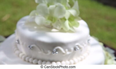 wedding cake decorated with orchid and bead - closeup fresh...