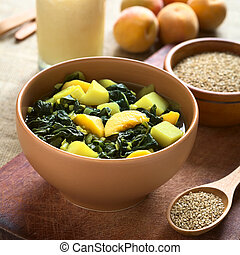 Spinach, Peach and Potato Curry Dish - Bowl of spinach,...