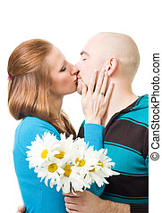 Happy couple kissing - Couple kissing standing in profile...