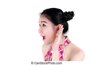 Asian woman listening with her hand on an ear