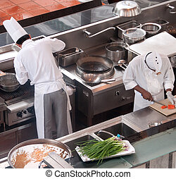 two chefs preparing for the evening meal at resort