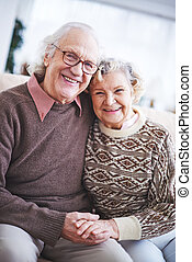 Ecstatic seniors - Laughing senior couple in sweaters...