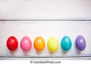 Row of Easter eggs - Row of painted Easter eggs on white...