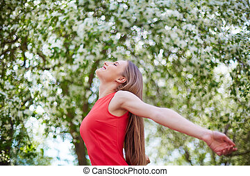 Enjoying nature - Ecstatic girl taking pleasure in summer...