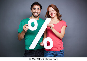 Good discount - Affectionate couple showing percentage...