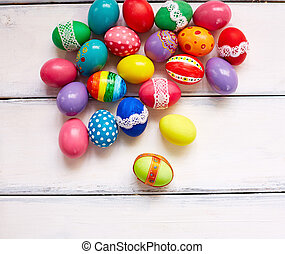 Easter craft - Creatively painted Easter eggs on white...