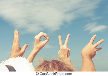 Love  sign language at the day time