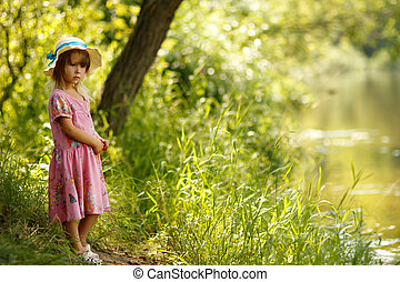 beautiful little girl on the nature - a beautiful little...