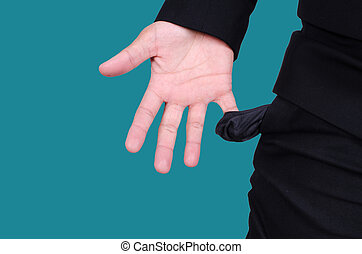 Business man showing his empty pockets on blue background