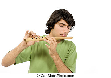 Playing with flute - Close-up of man playing with the wooden...
