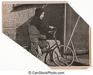 Little boy on a bicycle.
