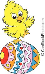 Easter chick - Little yellow chick on a colorfully painted...