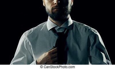 Tie the Knot - Mid-section of man putting his tie on in the...