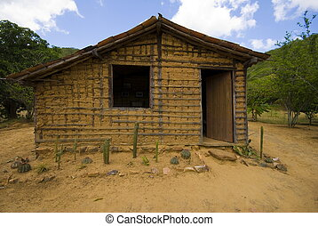 Poor house - Poor mud house in the arid weather .