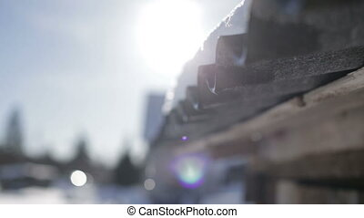 Spring thaw - Drops of water from the roof on a sunny spring...