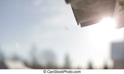 Spring thaw - Melting snow on the roof with a shallow depth...