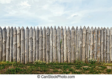 Fence log with flowers