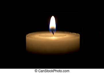 White thick candle with small flame on black