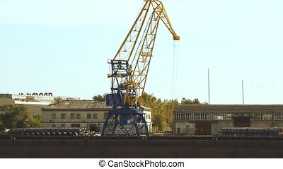 crane in the port moves loads