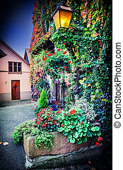 House decorated with colorful flowers