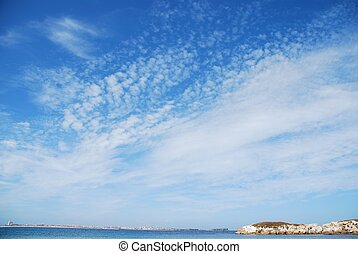 Huge rock at Baleal beach dramatic cloudscape - stunning and...