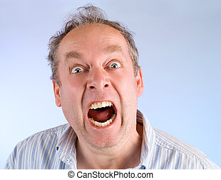 Man Screaming about Something - A middle-aged man is...
