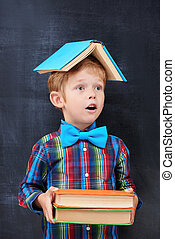 Mixed-up ginger school-boy overloaded with books - Redhead...