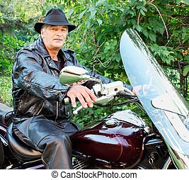 Middle-Aged Man Riding Motorcycle
