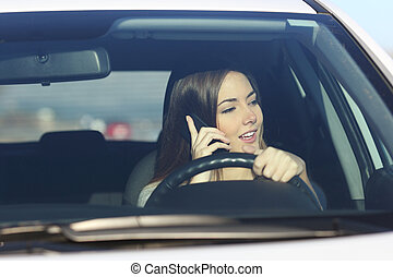 Driver driving a car distracted on the phone - Driver woman...