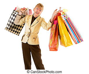 Senior Woman on a Shopping Spree - A proud senior woman is...