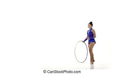 Tender  gymnast  dance with hula hoop, slow motion