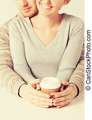 woman and man with take away coffee cup - woman and man...