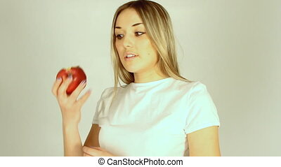 Young beautiful sexy girl holding big red apple to enjoy the...