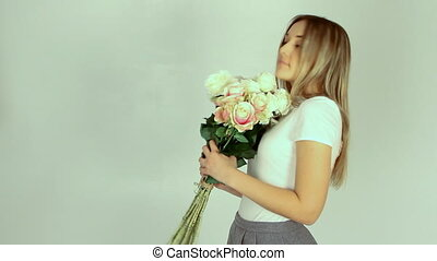 Young romantic woman with bouquet o - Young romantic woman...