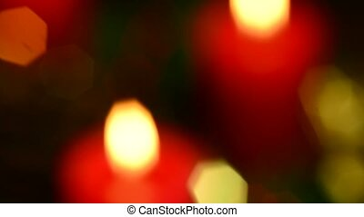 advent wreath with burning candles blurred on a turn table