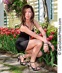 Sexy Lady in Front of Tulips - A sexy lady on a stone...
