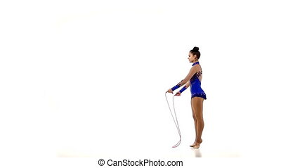 Professional artistic gymnast performs tricks, slow motion -...