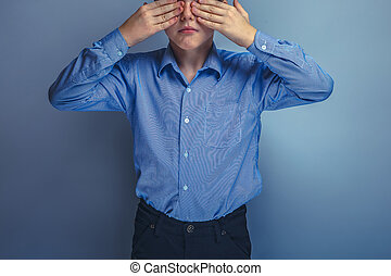 teenager boy Caucasian appearance eyes closed hands unknown...