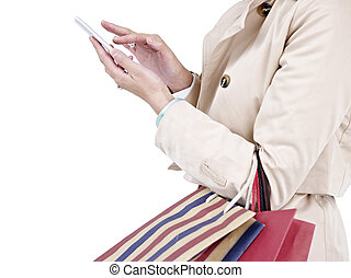 woman using cellphone - woman with shopping bags using...