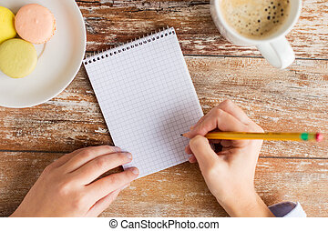 close up of hands, notebook, coffee and cookies - business,...
